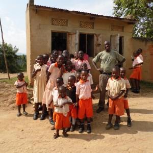 Happy Ivan and The Ntungamo Parents School children
